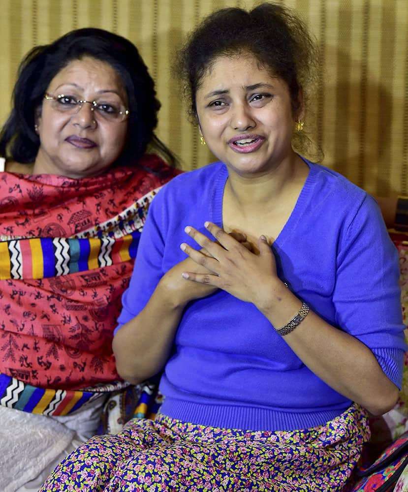 Aam Aadmi Party (AAP) leader Somnath Bhartis wife Lipika Mitra with Delhi Commission for Women chairperson Barkha Shukla Singh during a news conference in New Delhi.