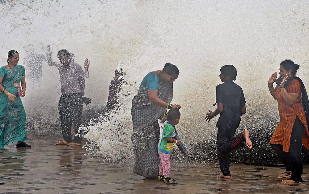 Mumbaikars enjoy high tide during monsoon season in Mumbai.