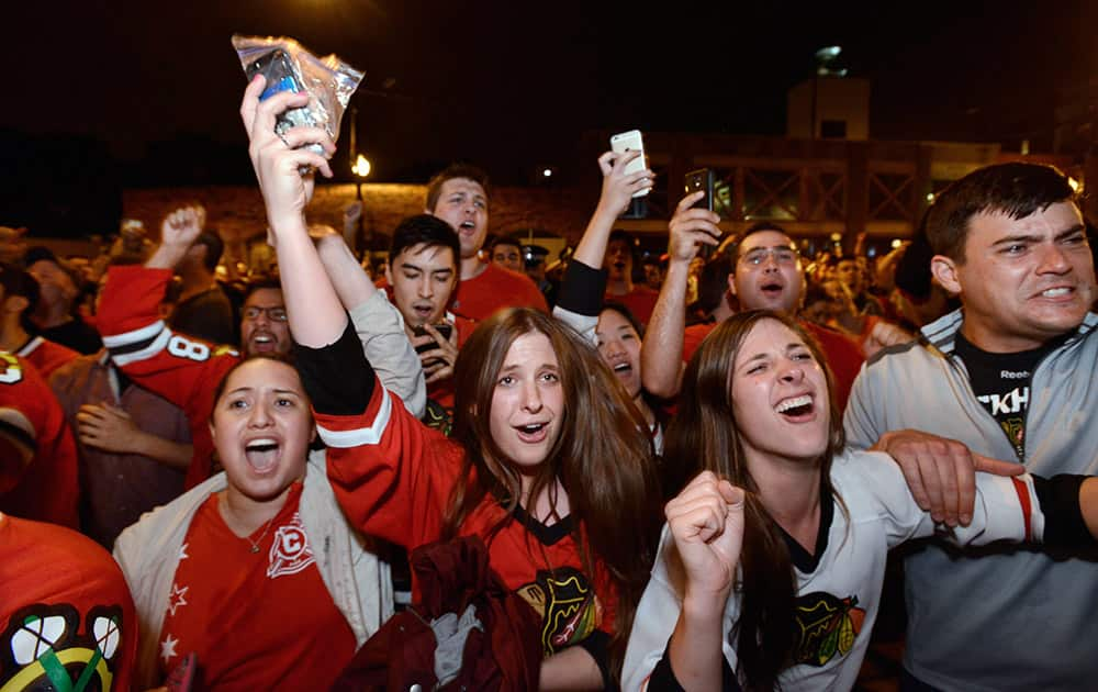 Chicago Blackhawks fans celebrate on Clark Street in the Wrigleyville neighborhood of Chicago after the Chicago Blackhawks defeated the Tampa Bay Lightning to win the NHL hockey Stanley Cup.