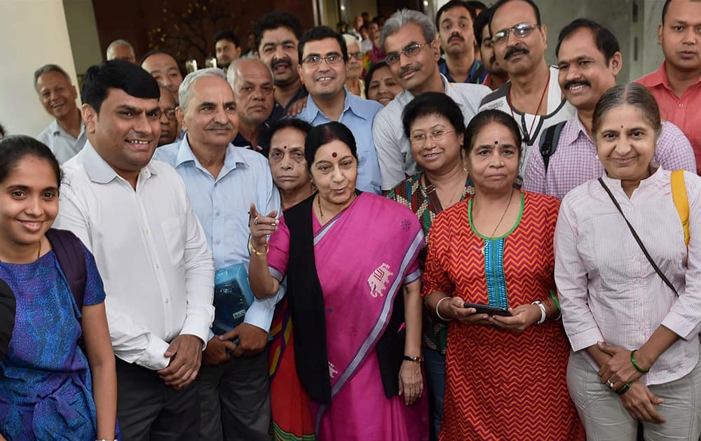 External Affairs Minister Sushma Swaraj with pilgrims during the flag off ceremony of the first batch of Kailash Mansarovar Yatris, who will travel by new route from Nathu La pass, in New Delhi.