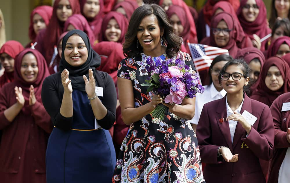 US first lady Michelle Obama is greeted by pupils and teachers at Mulberry School for Girls in east London. Michelle Obama is due to meet with female students in London on Tuesday to encourage them to pursue top educational goals.