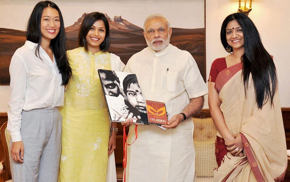 Prime Minister Narendra Modi meeting representatives of Girl Rising campaign in New Delhi.