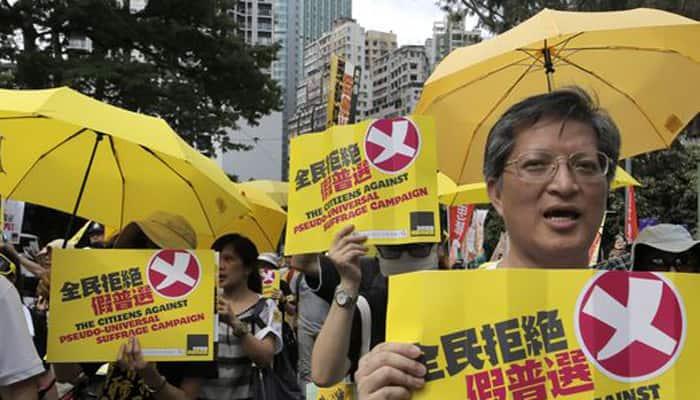 Passions run high ahead of Hong Kong debate on China-vetted democracy plan