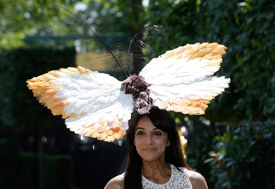 Jackie St Clair poses for photographers as she arrives for the first day of Royal Ascot horse racing meet at Ascot, England.
