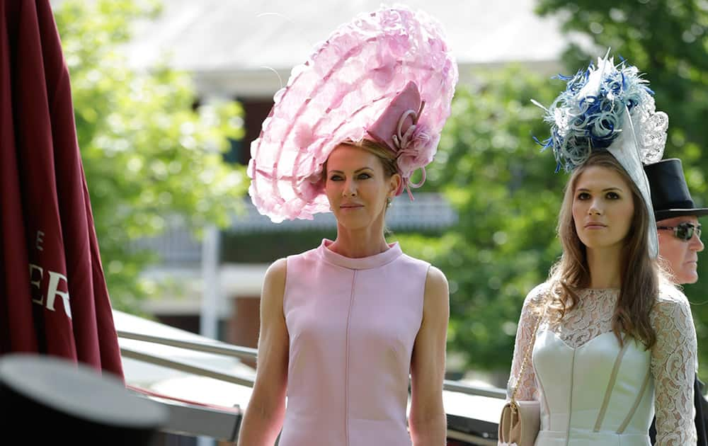Belinda Studwick with her daughter Alexandra wait for TV interview on the first day of Royal Ascot horse racing meet at Ascot, England.