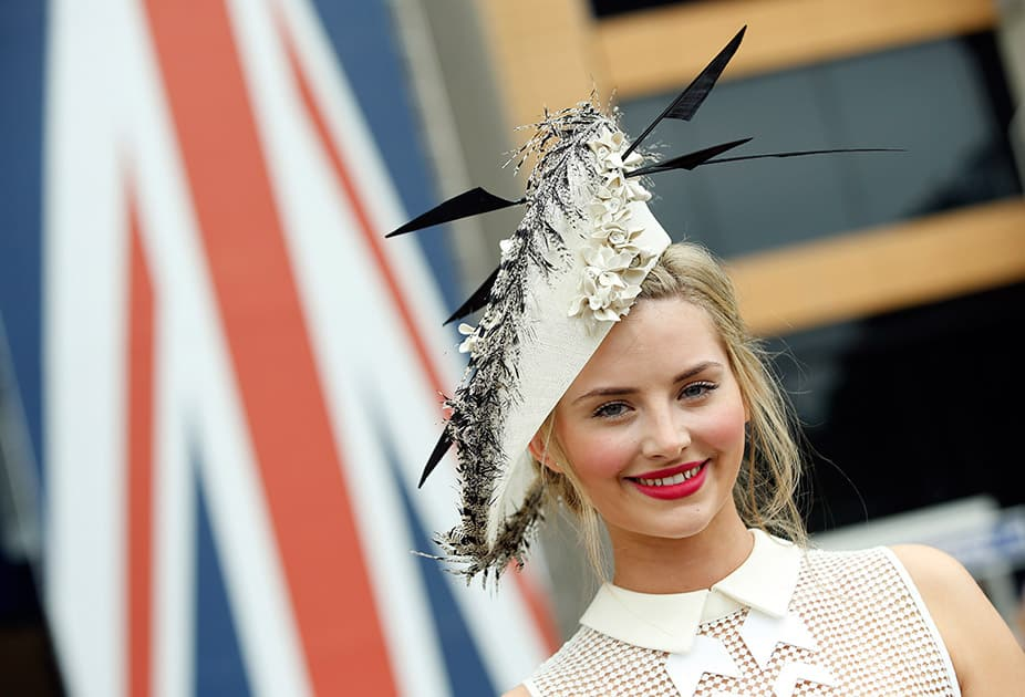 Eleanor Matthews poses for photographers as she arrives for the second day of Royal Ascot horse racing meet at Ascot, England.
