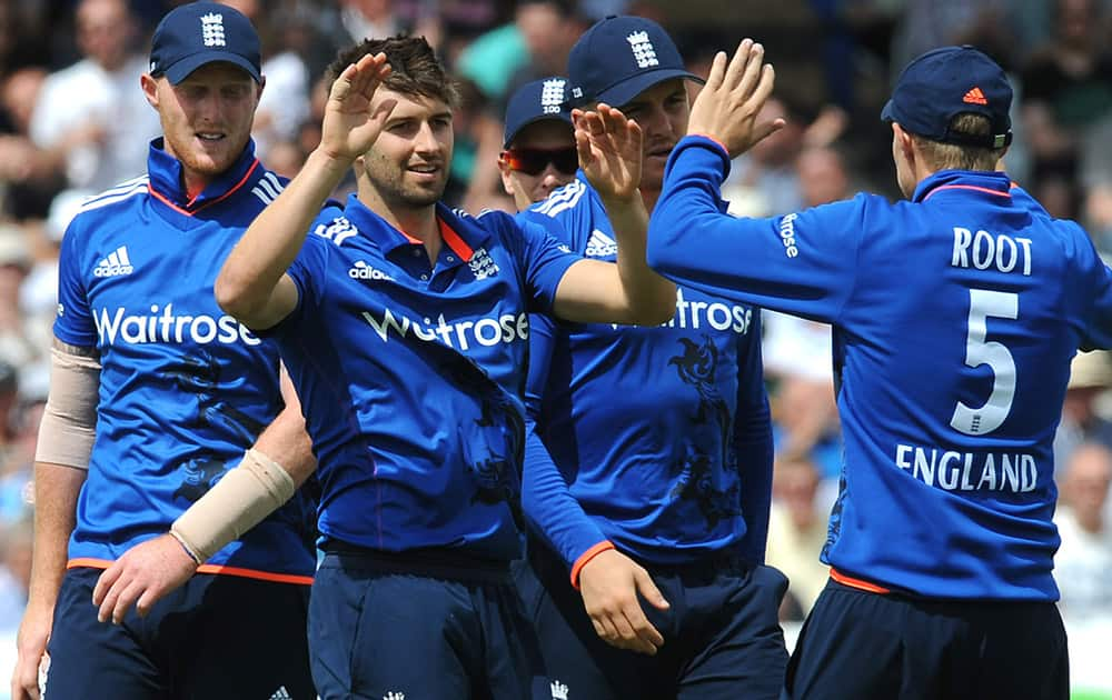 England's Mark Wood is congratulated by teammates after bowling New Zealand's Brendon McCullum caught Jos Butler for 35 runs during the fourth One Day International match between England and New Zealand at Trent Bridge cricket ground in Nottingham, England.