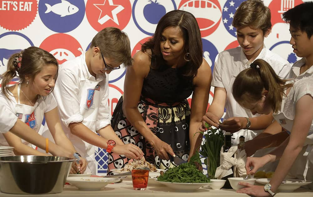 US first lady Michelle Obama participates in a cooking demonstration at the James Beard American Restaurant with Italian and American middle school students in Milan, Italy.