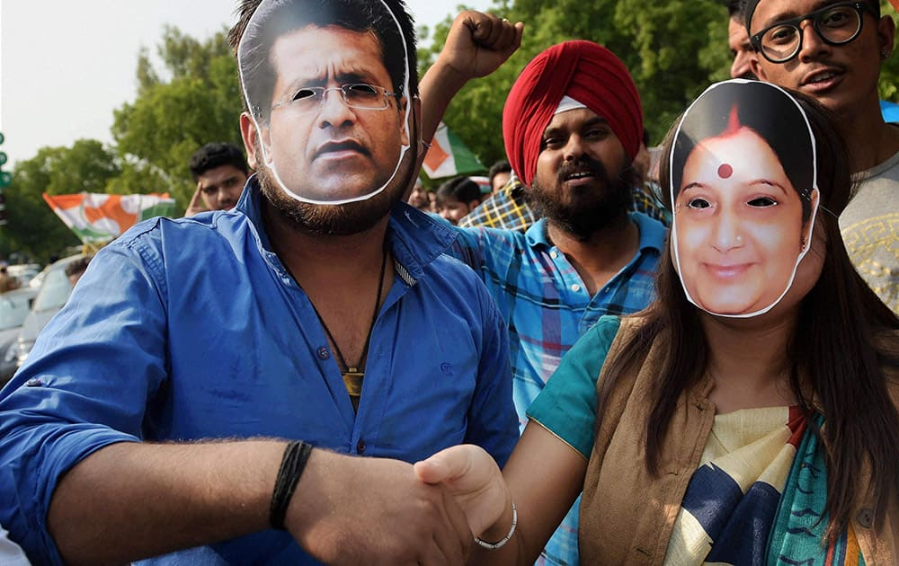 Youth Congress members wearing Lalit Modi and Sushma Swaraj masks during a protest at Teen Murti in New Delhi. Swaraj facilitated former Indian Premier League (IPL) chief Lalit Modi's travel to Portugal for his wife's treatment last year.