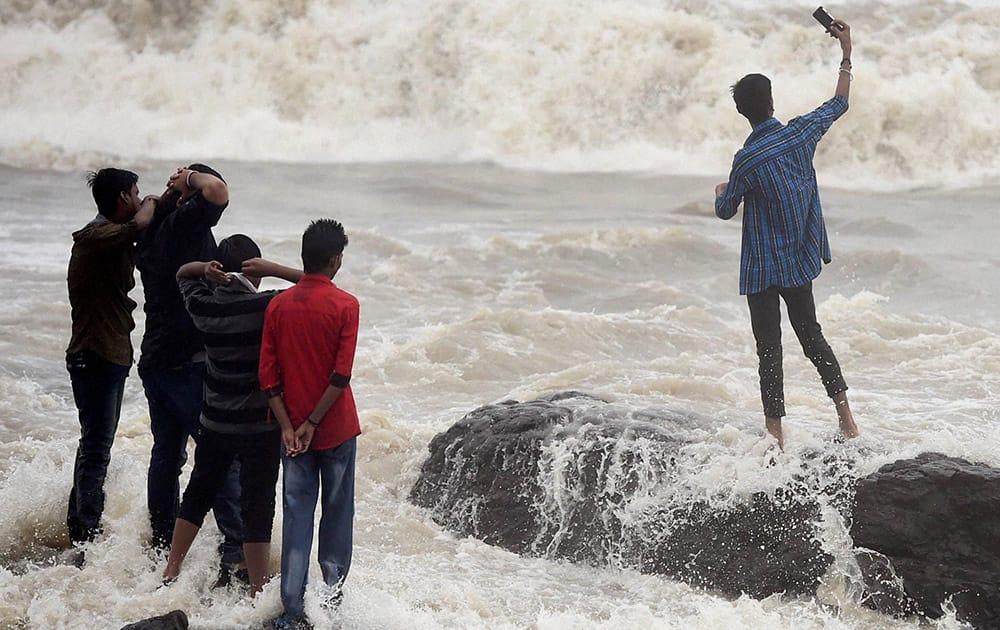 Mumbaikars enjoy high tide during monsoon season.