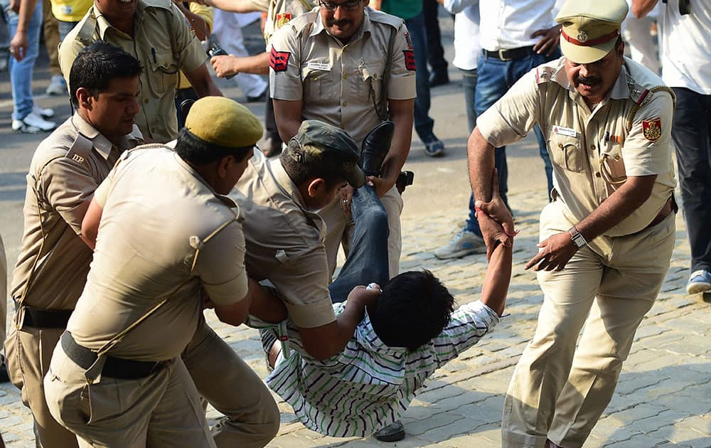 Youth Congress members being detained by the police during their protest against union Minister Sushma Swaraj at Teen Murti in New Delhi.