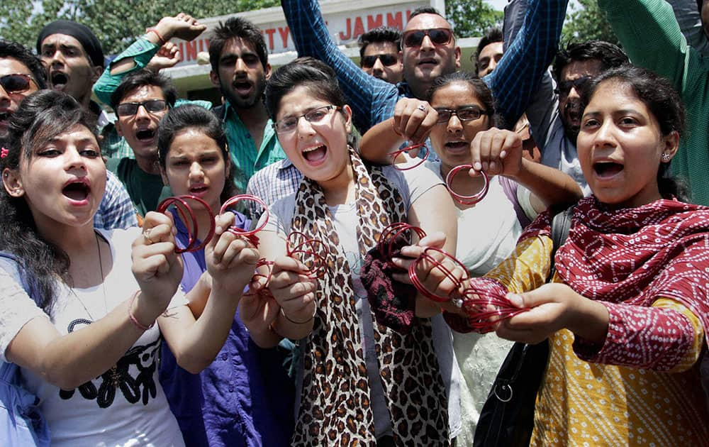 Student show bangles at a protest against the governments decision to give AIIMS to Kashmir, in Jammu.