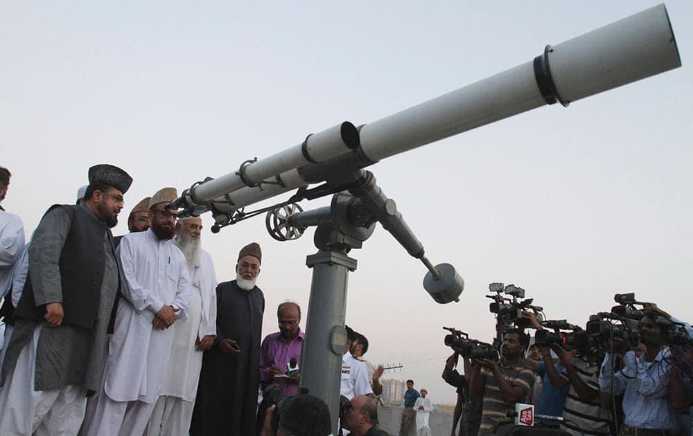 Pakistani clerics take part in a moon sighting event for Ramadan in Karachi, Pakistan.