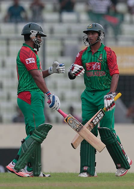 Bangladesh's Tamim Iqbal celebrates with his teammate Soumya Sarkar after hitting to the boundary for four runs during the first one-day international cricket match against India in Dhaka, Bangladesh.