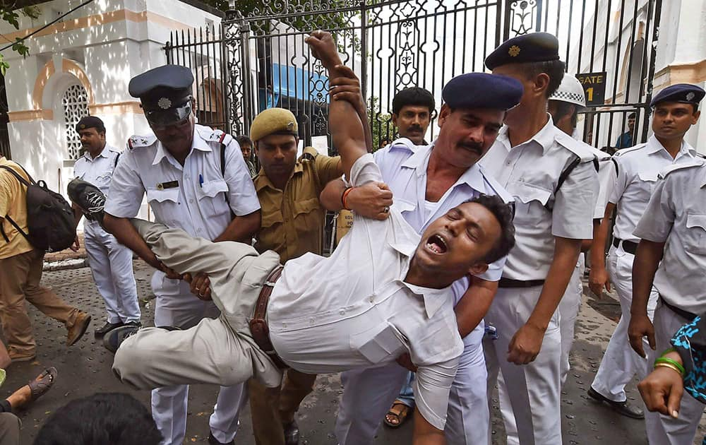 Police personal arrest Chit Fund sufferer during their protest aganist West Bengal Government in front of State Assembly in Kolkata.