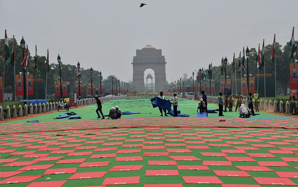 Workers during preparations for the upcoming Yoga Day celebrations at Raisina Hill in New Delhi.