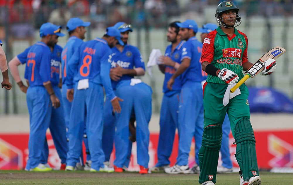 Bangladesh's Soumya Sarkar walks back after his dismissal by India's Suresh Raina during the first one-day international cricket match against India in Dhaka, Bangladesh.