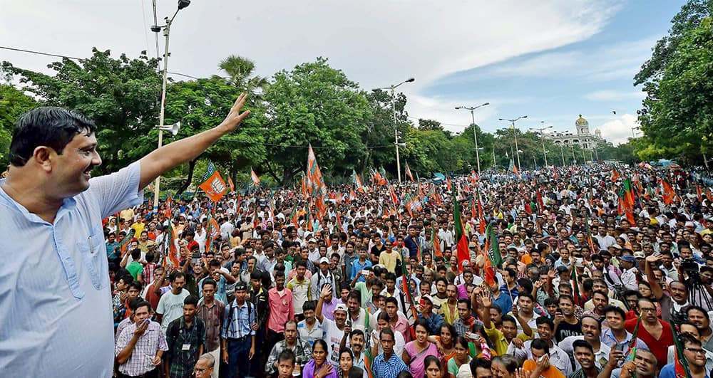 BJP State President Rahul Sinha waving hands to party activists participate in a rally in Kolkata on Thursday to protest against West Bengal Government for deteriorating law and order situation in the State and demanding minimum supporting price of rice for the poor farmers in the rural areas.