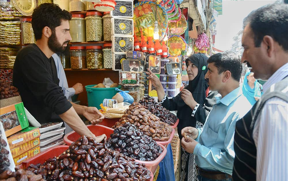 People buying dates on eve of holy month of Ramadan.
