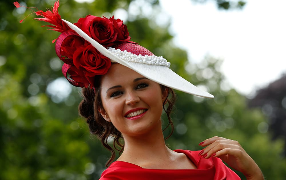 Jennifer Wrynne poses for photographers as she arrives for the third day of the Royal Ascot horse racing meet at Ascot, England.