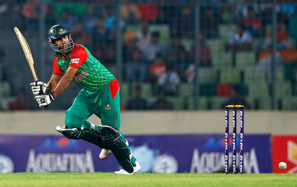 Mashrafe Mortaza plays a shot during the first one-day international cricket match against India in Dhaka, Bangladesh.
