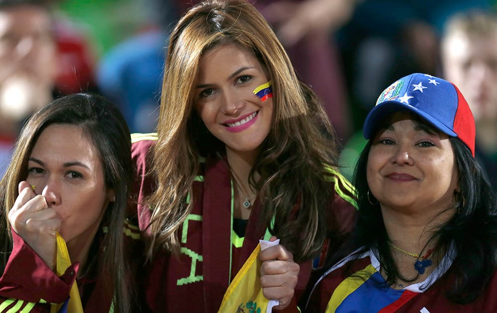 Venezuela's fan cheer for their team prior a Copa America Group A soccer match against Peru at the Elias Figueroa stadium in Valparaiso, Chile.