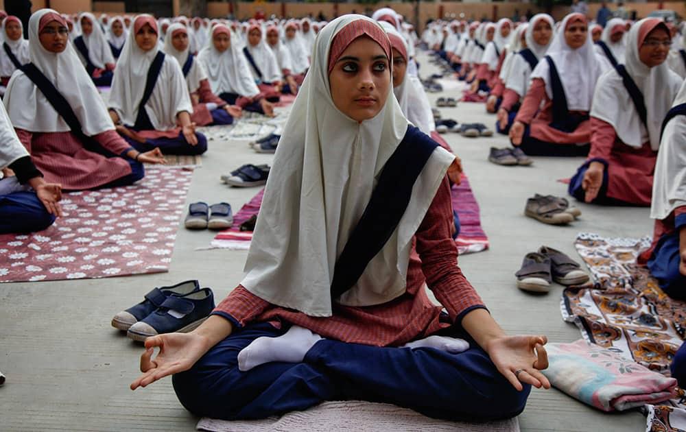 Muslim students practice yoga at a school ahead of first International Yoga Day in Ahmadabad.