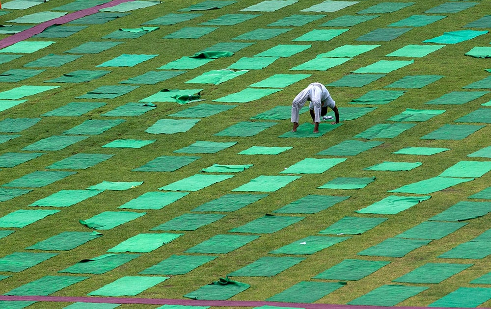 A man performs yoga in a stadium in New Delhi.