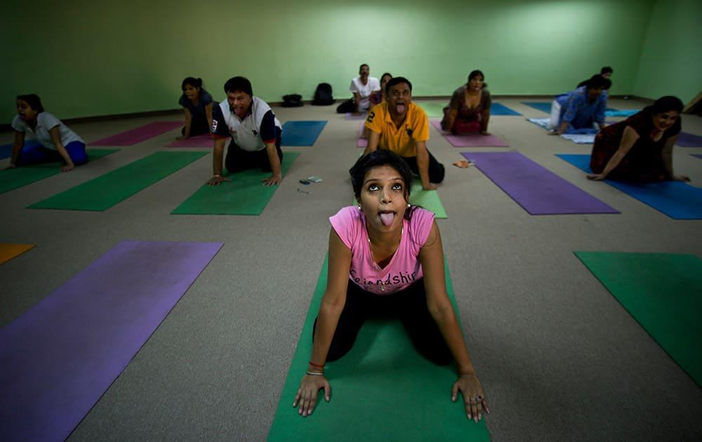 People perform yoga at the Morarji Desai National Institute of Yoga, in New Delhi.