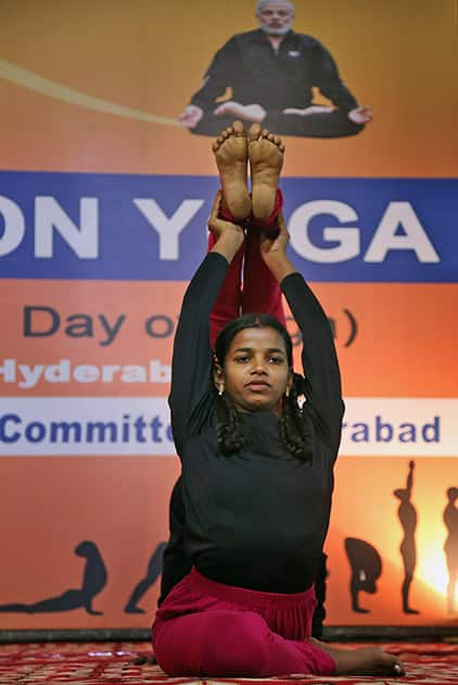 Children participate in a yoga convention program in Hyderabad. Sunday, June 21, marks the first International Yoga Day, which the government of India's Prime Minister Narendra Modi is marking with a massive outdoor New Delhi gathering.