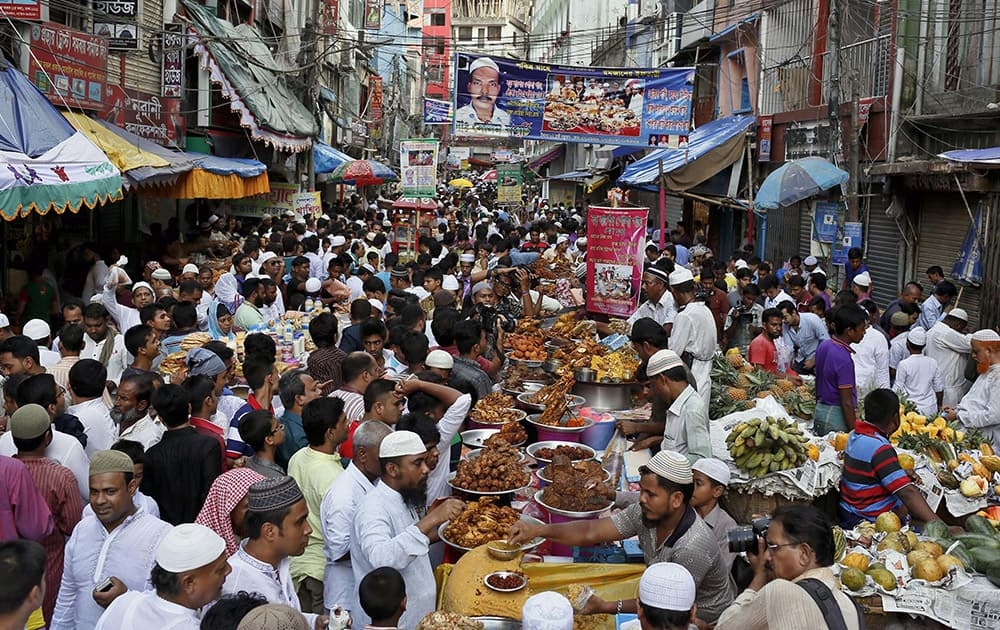 A crowd of Muslim devotees buy food in a market to break the first day of fasting in Dhaka, Bangladesh.