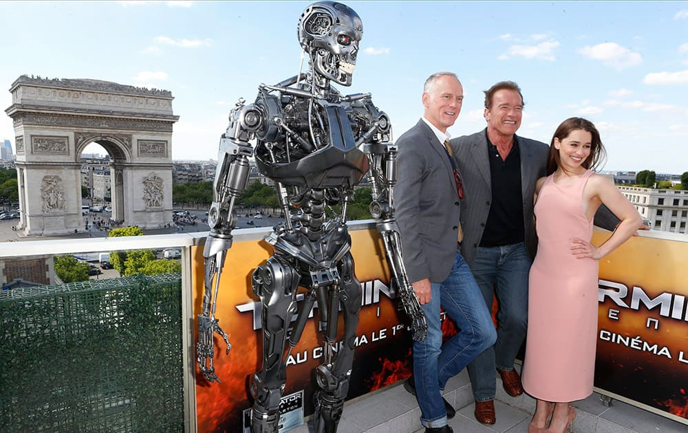British actress Emilia Clarke, Austrian born actor Arnold Schwarzenegger and US director Alan Taylor, pose for photographers at a preview of the film, Terminator: Genisys, in front of Arch of Triumph, in Paris.
