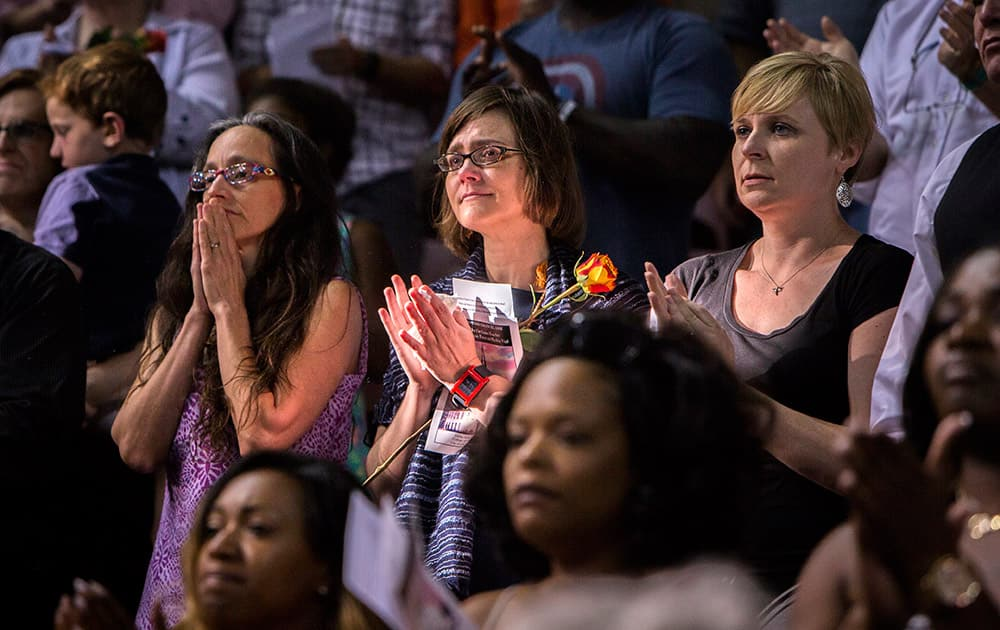 Mourners gather for a memorial service for the victims of a shooting Wednesday at Emanuel AME Church, in Charleston, S.C. Dylann Roof is accused of killing nine people inside the church.