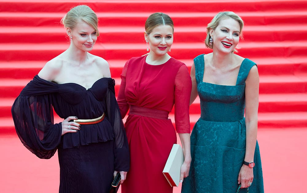 Russian actresses Svetlana Khotchenkova, Maria Kozhevnikova, and actress and director Renata Litvinova, pose for photographers at the opening ceremony of the 37th Moscow International Film Festival in Moscow, Russia.