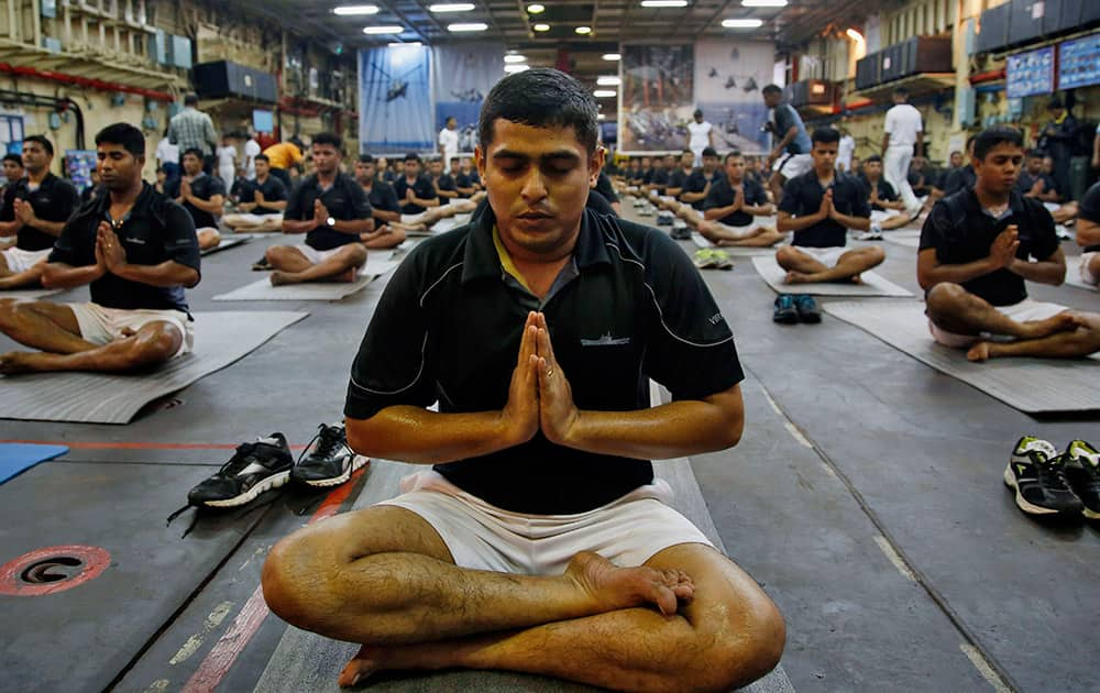 Indian Navy men perform Yoga during rehearsals for the International Yga Day to be marked on June 21, in Mumbai.