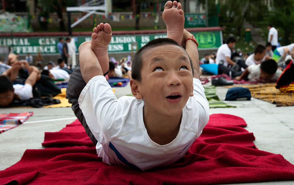 A young Exile Tibetan practices yoga at the Tibetan Children's Village School in Dharmsala, India.