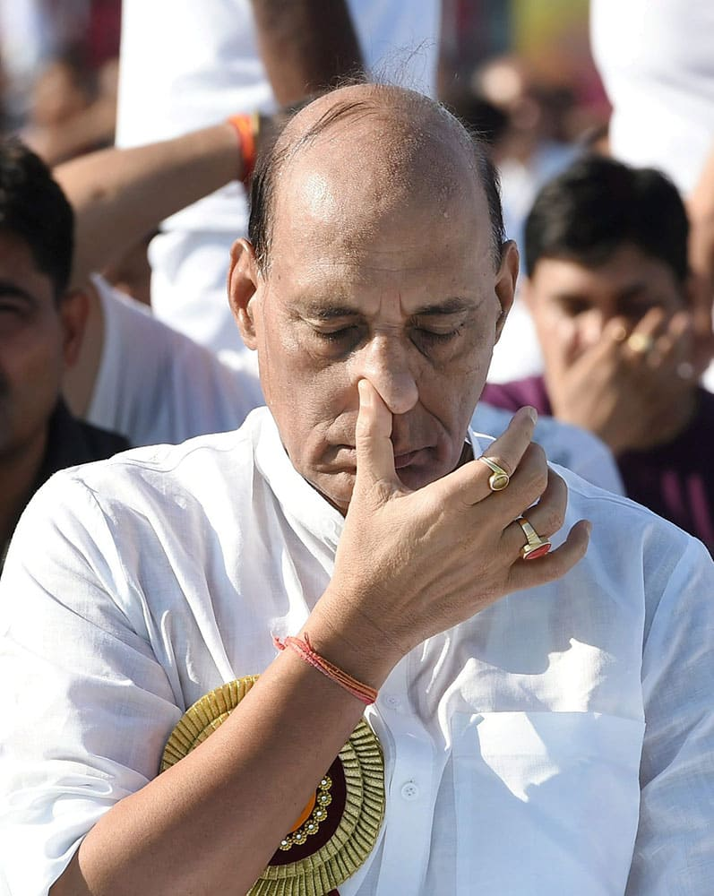 Union Home Minister Rajnath Singh performs Yoga at a mass yoga session to celebrate International Day of Yoga 2015 in Lucknow.