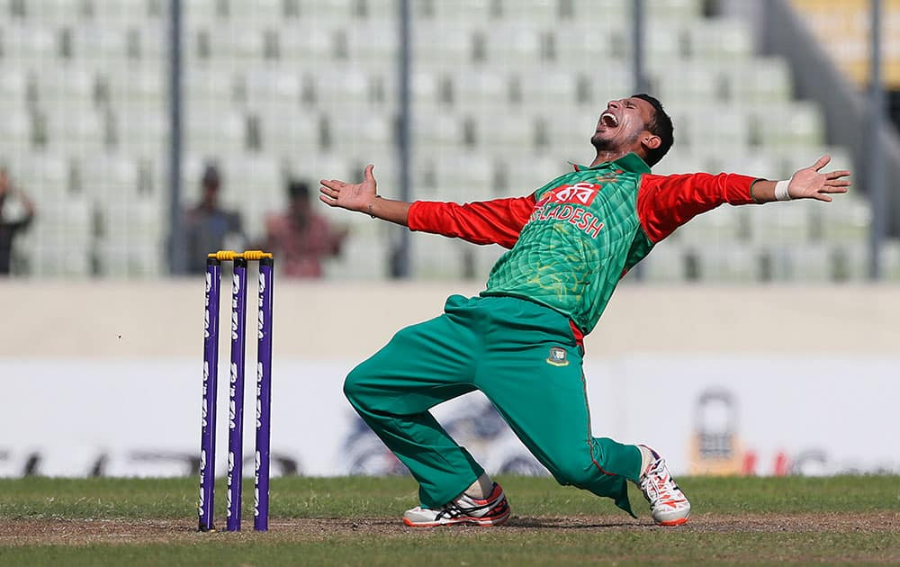 Bangladesh's Nasir Hossain successfully makes an LBW appeal for the dismissal of India's Virat Kohli during their second one-day international cricket match in Dhaka, Bangladesh.