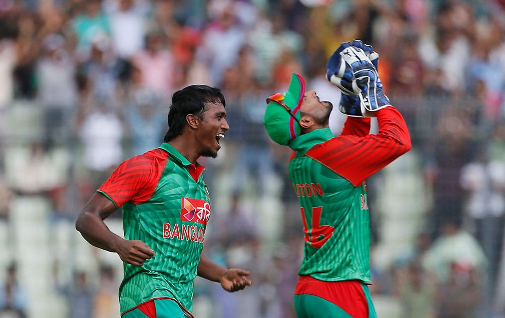 Bangladesh's Rubel Hossain, left, and Litton Das celebrates the dismissal of India's Ambati Rayudu during their second one-day international cricket match in Dhaka, Bangladesh.