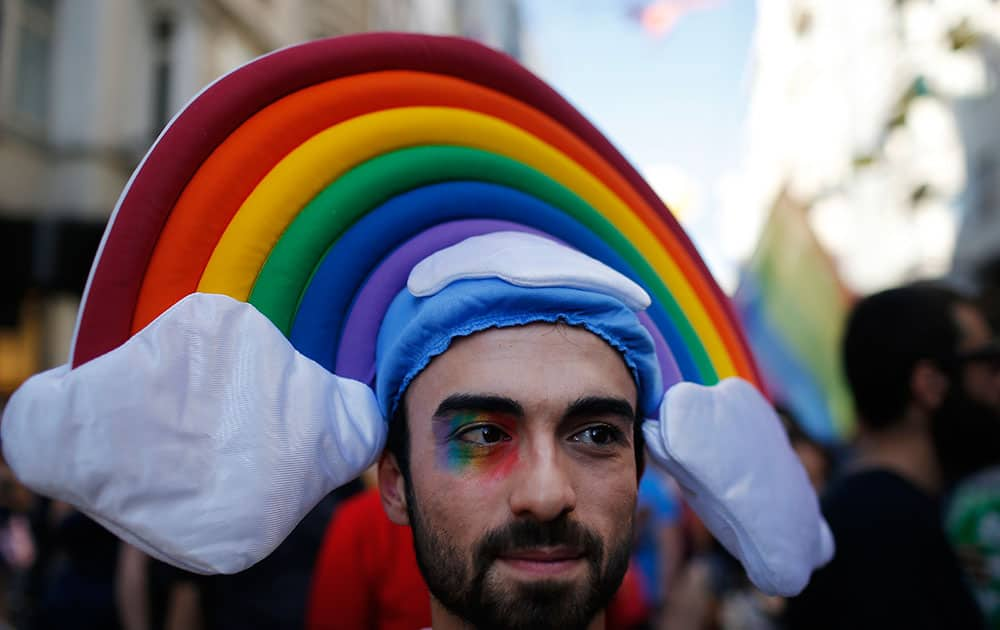 A man participates in the 'Trans Pride' parade in support of Lesbian, Gay, Bisexual and Transsexual LGBT rights, in Istanbul, Turkey.