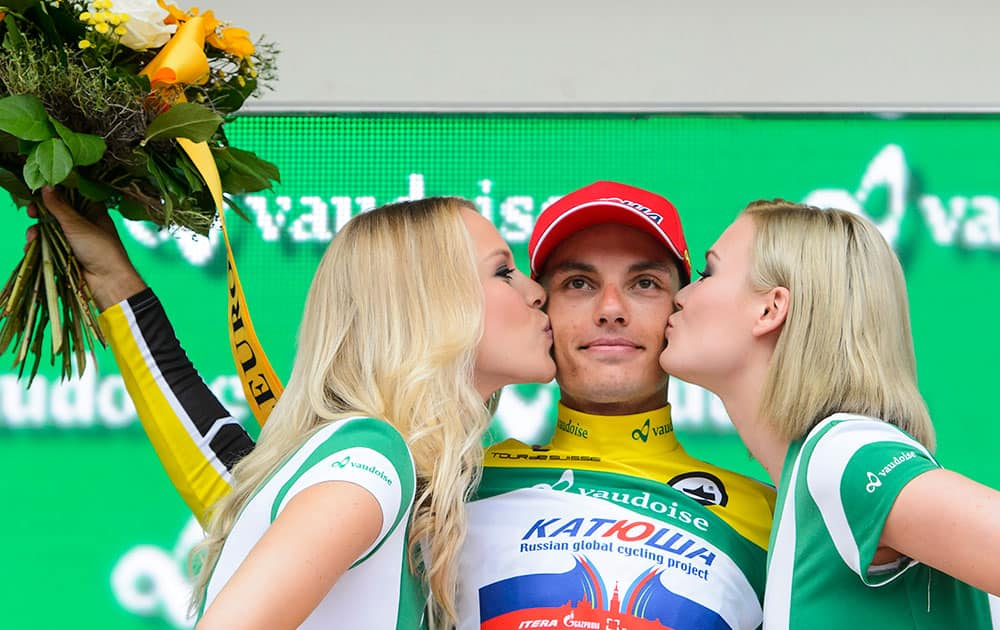Winner Simon Spilak from Slovenia of team Katusha, center, is kissed by two hostesses on the podium after the 9th and last stage, a 38,4 km race against the clock, from Bern to Bern, at the 79th Tour de Suisse UCI ProTour cycling race, in Bern, Switzerland.