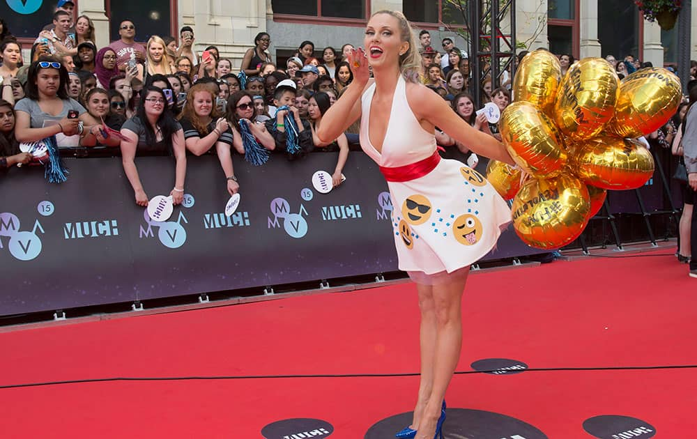 Nicole Arbour poses on the red carpet during the 2015 Much Music Video Awards in Toronto.
