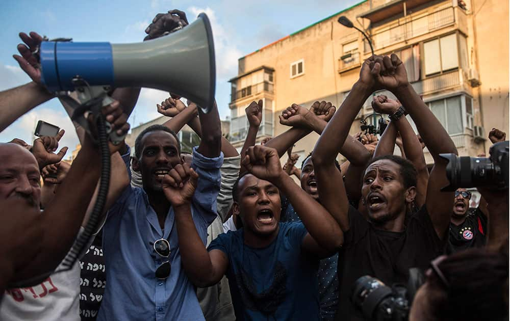 Ethiopian Jewish men chant during a protest in Tel Aviv, Israel.