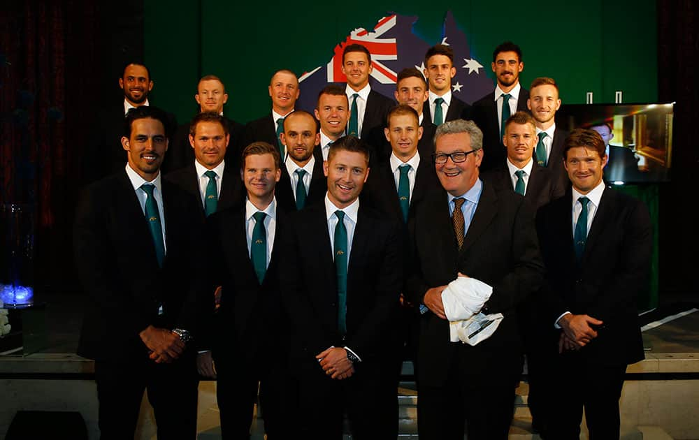The 2015 Australian Cricket team pose with the Australian High Commissioner Alexander Downer, front center, next to the captain Michael Clarke, during a welcome party at the Australian High Commission in London.