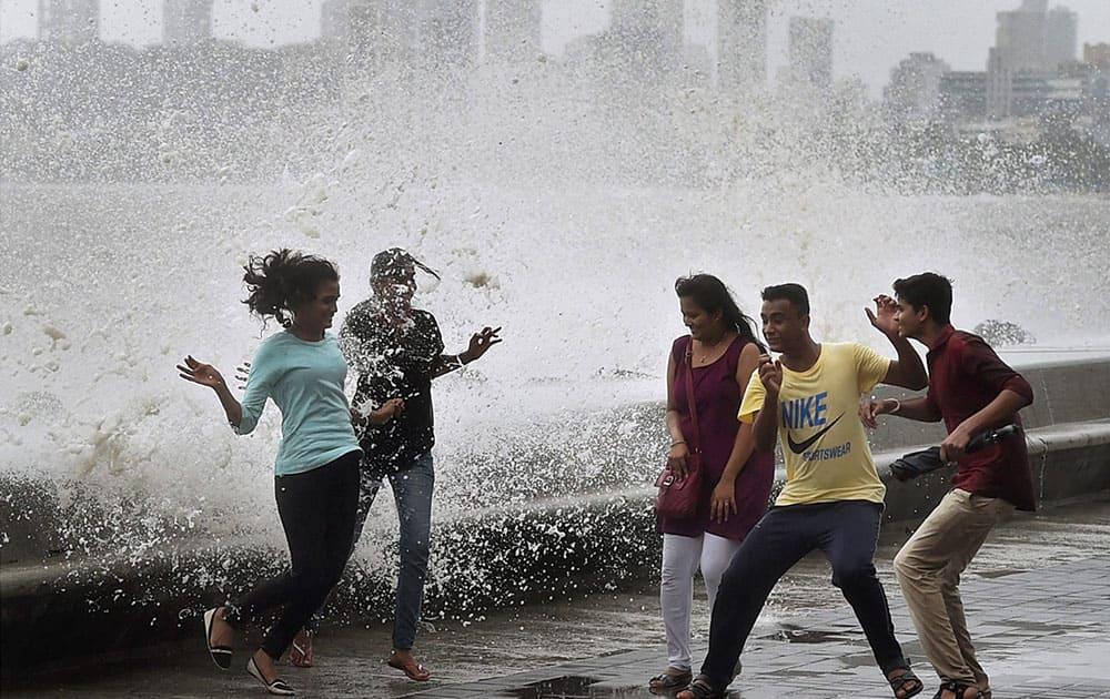 Mumbaikars enjoy high tide at the Marine drive in Mumbai.
