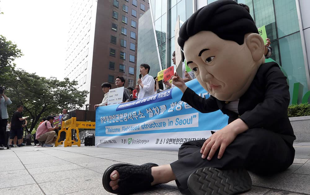 A South Korean university student wearing a mask depicting North Korean leader Kim Jong Un performs during a gathering to welcome the opening of the U.N. human rights office in Seoul, South Korea.