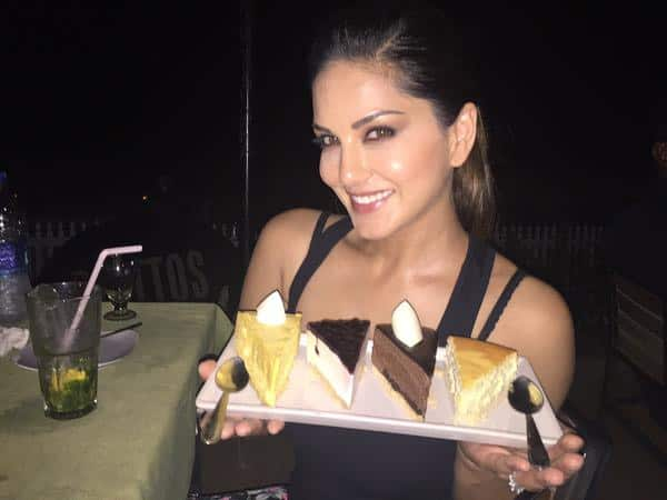 This is how @hitendra1480 tortures me. He steals my cakes all the time. Lol love you my food FBI. Twitter@SunnyLeone