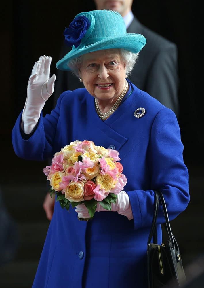 Britain's Queen Elizabeth II waves as she arrives at her hotel in Germany's capital Berlin.