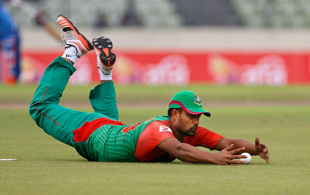 Tamim Iqbal dives to stop the ball as he fields against India during their third one-day international cricket match in Dhaka.