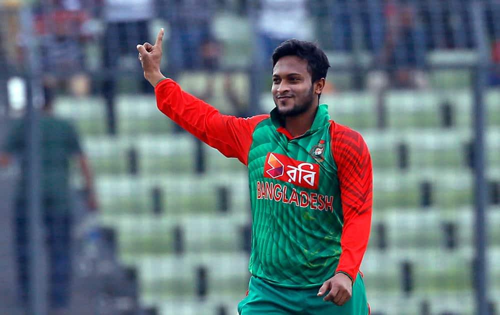 Shakib Al Hasan celebrates the dismissal of Virat Kohli during their third one-day international cricket match in Dhaka.